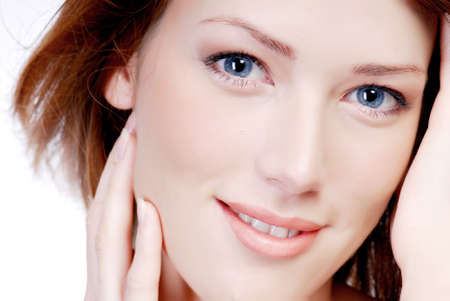 feminity: portrait of close-up  young adult  woman face with the smile