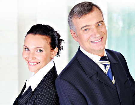 A business team of a senior male executive and a beautiful young woman. Stock Photo - 3706691