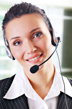 An office executive working as a customer support personnel, wearing a mic headset. Stock Photo - 3704553