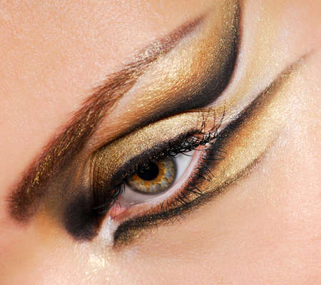 bodily: Close-up womans eye with multicolored stylish make-up