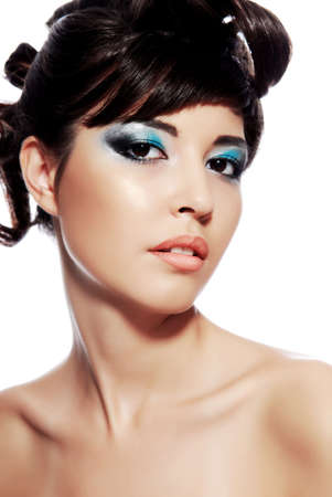 Beautiful young woman face with multicolored make-up and modern hairstyle. Stock Photo - 3704542