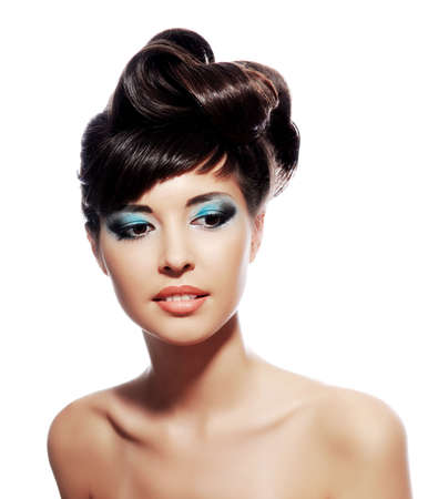 neck: Multicolored creativity make-up with stylish hairstyle. Close-up portrait of young beautiful woman.