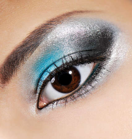Multicolored beauty make-up on the human eyelid.  Stock Photo - 3704570