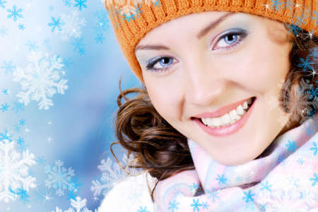 Happy young woman face with beauty smile dressed in the winter hat, scarf. People winter concept. Stock Photo - 3704560