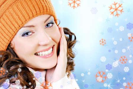 Cheerful woman face clothing in warm orange hat. Winter season. photo