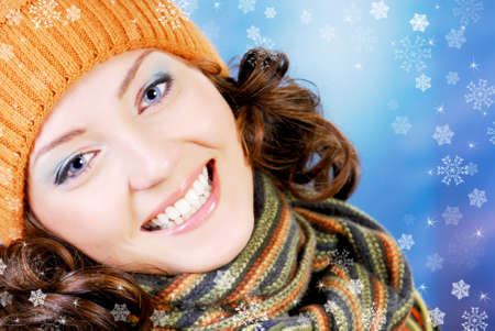 Close-up smiling face of young teen female dressed in winter warm orange hat Stock Photo - 3704569
