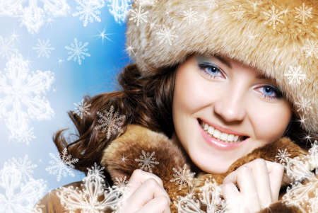 CLose-up beautiful face of young woman in fur hat photo