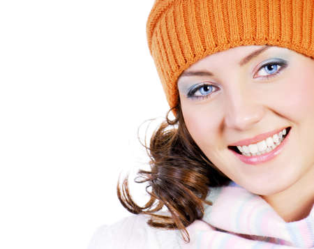 Beautiful young woman face close-up dressed in winter hat. photo