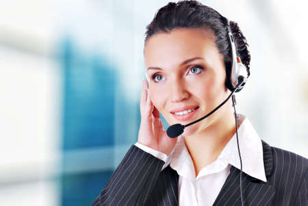 operators: Woman wearing headset in office; could be receptionist