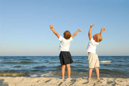 Freedom. Two boys on the beach with arms raied Stock Photo - 3709598