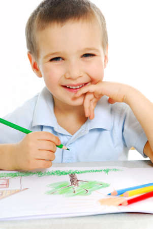 caucasian: Cute preschooler boy draw using the green crayon