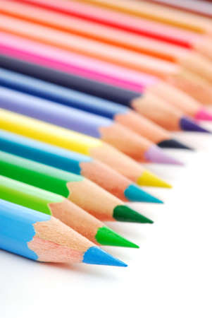 Group of multicolored pencils in a row photo