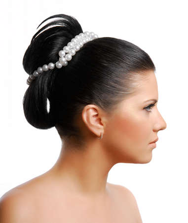 female profile:  beautiful wedding  hairstyle on young adult woman Stock Photo