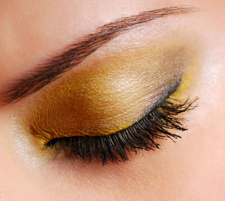 Fashion make-up — Bright yellow eyeshadow on eyes closed