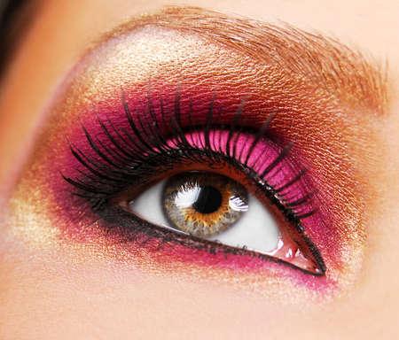 eyelid: beautiful golden make up and pink eyeshadow on a eyelid