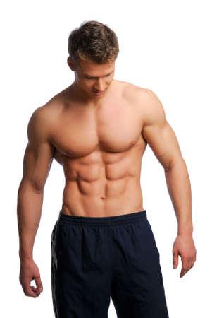 Sport en lichamelijke gezondheid van de jonge man. Geïsoleerd op wit.