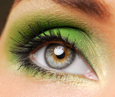 Female eyes with bright green color
