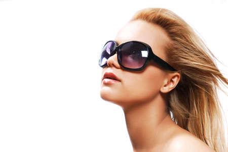 Young woman wearing the big modern sunglasses. Studio shot on a white background photo