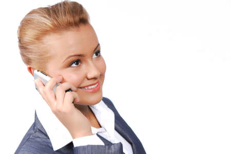 Cute businesswoman speaking on the phone. Isolated on the white background Stock Photo - 3774978