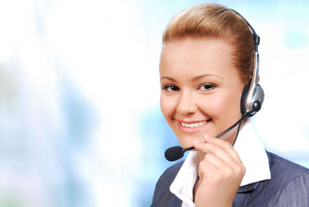 call center office: Smiling bussinesswoman speaking by hands-free. Isolated on the white background