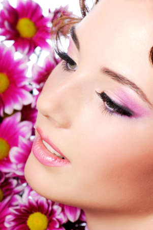 Face of a young beautiful woman. Flowers on the background Stock Photo - 3822397