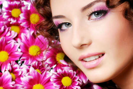 Beutiful girl portrait with pink flowers photo