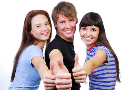 Three young teenagers laughing and giving the thumbs-up sign. Stock Photo - 3836177
