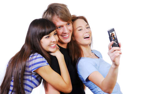 Three beautiful young teenagers taking their self-portrait. Stock Photo - 3836176