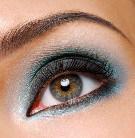 ceremonial: Beautiful female eye with fashion ceremonial makeup