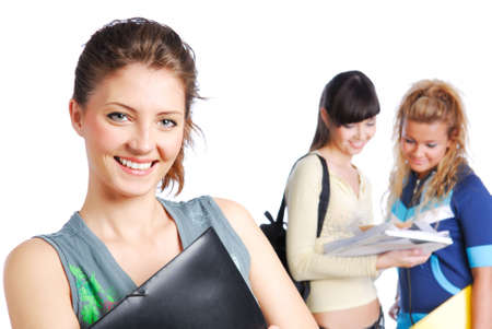 studygroup: Portrait of cute girl holding folder in hands on background of the students Stock Photo