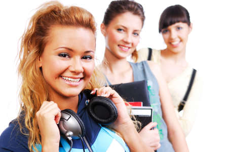Portrait of a beautiful young funny only female students on a white photo