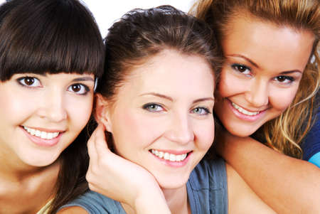 Portrait  of three smiling attractive girlfriends with beautiful eyes photo