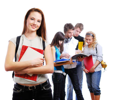 Graceful female student with books in hands looking at camera. On a background classmates photo