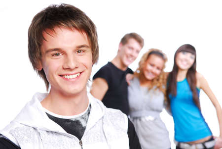 Portrait of a young beautiful teen boy. Friends on a background. photo