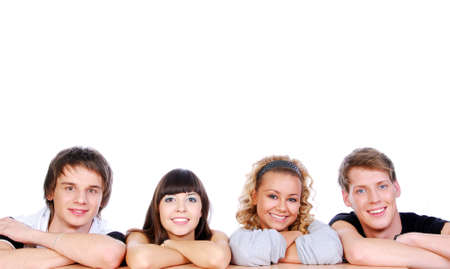 Portrait of four happiness young guys and girls isolated on white photo