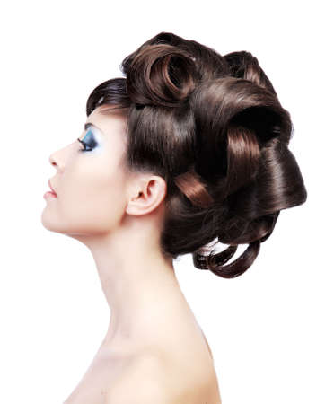 Wedding hairstyle. Profile portrait of a cute model with beautiful  locks.