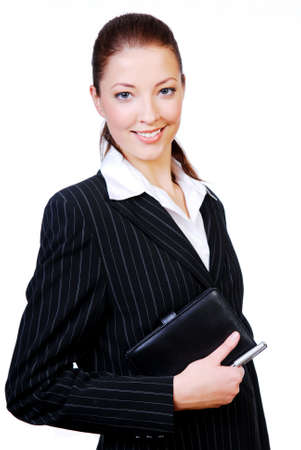 datebook: Portrait of a young successful businesswoman with a datebook and pen in  hands Stock Photo