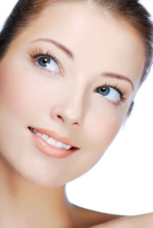 Close-up portrait of cheerful young adult girl - looking up  photo