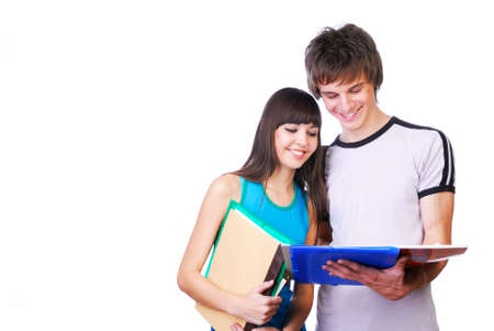 Two young adult students standing close and reading photo