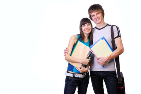 Two young adult students standing and embracing isolated on white Stock Photo - 3918072