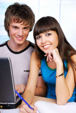 Two attractive students sitting with laptop - Clever people Stock Photo - 3918080