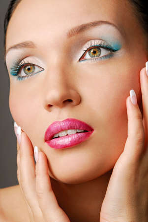 Beautiful face. Blue make-up for eyes. Green eyes.  photo