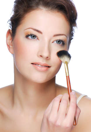 Portrait of cute young adult woman cleaning face after applying make-up Stock Photo - 3971119