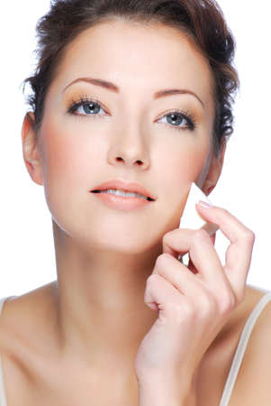 Close-up face of beauty young  woman applying face foundation