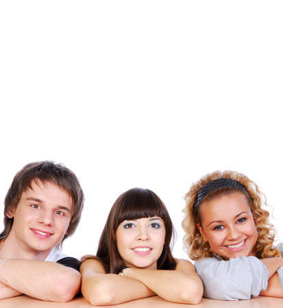 Portrait of three young attractive happy people photo