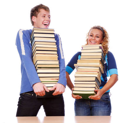 Two young adult students holding books and laughing photo