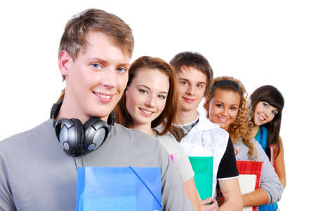Group of  cute  smiling students standing with books photo