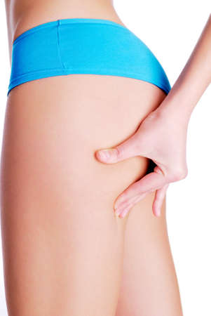 Woman pinching leg for skin fold test - studio shot on white Stock Photo - 4060801