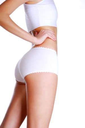 wit ondergoed: Profiel bekijken van mooie vrouw lichaam gekleed in het wit ondergoed Stockfoto