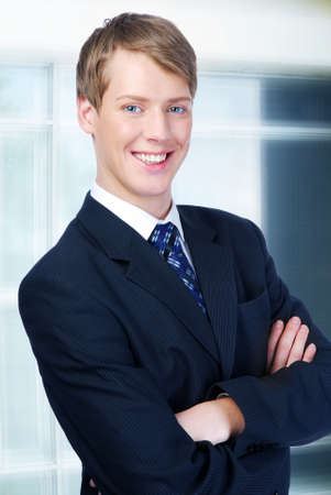 Portrait of a young cheerful businessman standing in office Stock Photo - 4053777